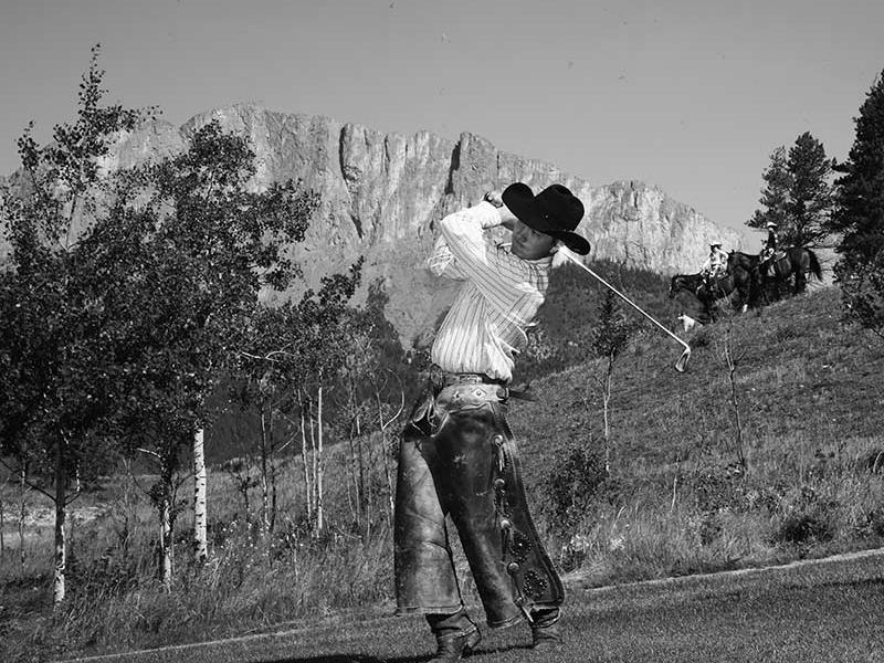 Brewster's Golf, Kananaskis Ranch - A cowboy teeing off.